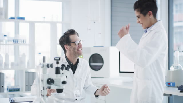 with science you'll always win - camice da medico video stock e b–roll