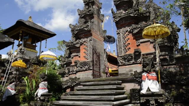 ms with temple umbrellas colorful decorated pura dalem puri temple / ubud, bali, indonesia - ubud district stock videos & royalty-free footage