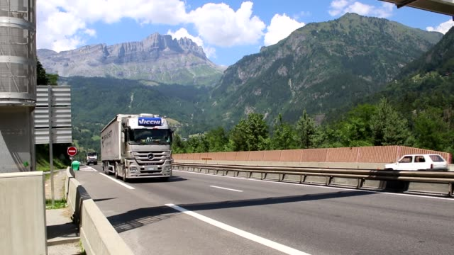 vídeos de stock, filmes e b-roll de with the cottian alps a mountain range in the southwestern part of the alps in the background they form the border between france and italy the... - tunnel
