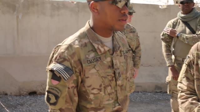ms with the help on an interpreter cpt alan causey from new orleans louisiana with the us army's 4th squadron 2d cavalry regiment question an afghan... - 言語翻訳点の映像素材/bロール