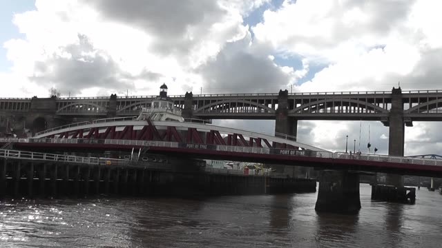 with the high level bridge in the background and white and dark clouds in the sky - river tyne stock videos & royalty-free footage