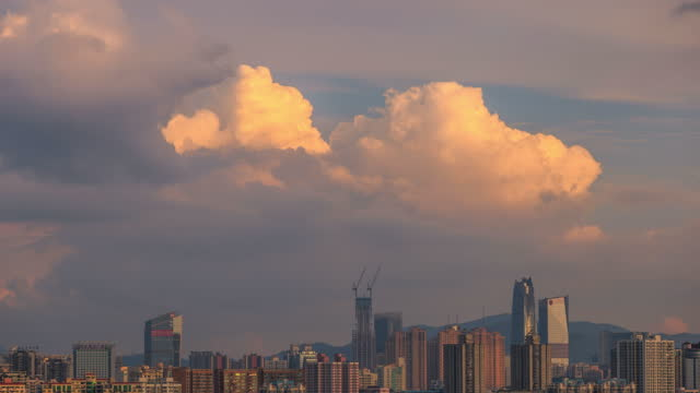 with the sunrise and clouds, the crowded city also appears soft - ethereal stock videos & royalty-free footage