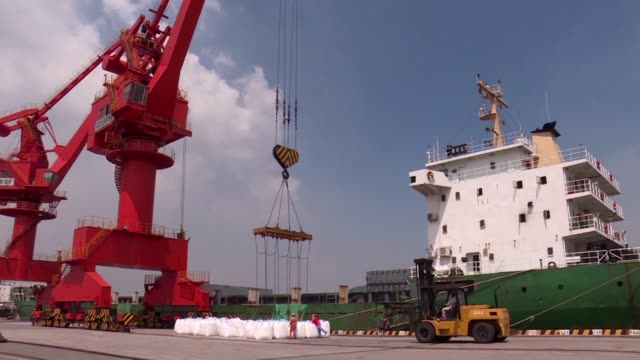 with trade growth set to slow sharply amid a trade war between the united states and china the imf cut its outlook for global gdp by two-tenths to... - trade war stock videos & royalty-free footage