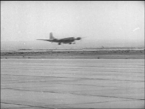B29 with Yeager's Bell X1 airplane taking off from airfield / California / newsreel