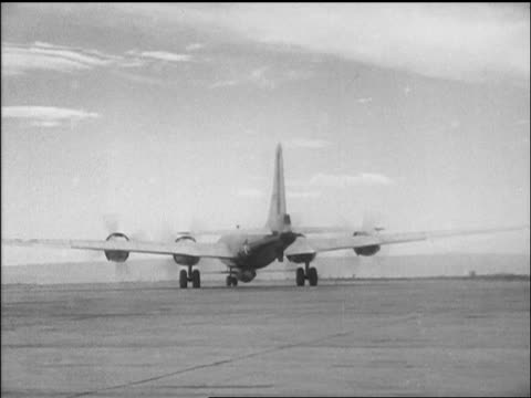 B29 with Yeager's Bell X1 airplane taxiing on airfield / California / newsreel