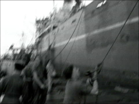 withdrawal of british troops from port said egypt port said ext various shots lorries being loaded onto ships in port / shots of crane lifting trucks... - port said stock videos & royalty-free footage