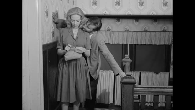 stockvideo's en b-roll-footage met 1962 a withdrawn woman brings her drunk date back to her room - opwinding