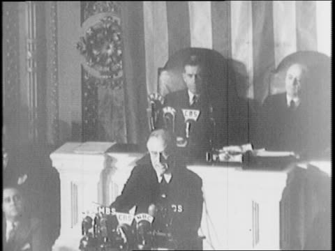 within the house of representatives, president franklin d roosevelt delivers his war message in front of congress and america, 'a date which will... - 1941 stock videos & royalty-free footage