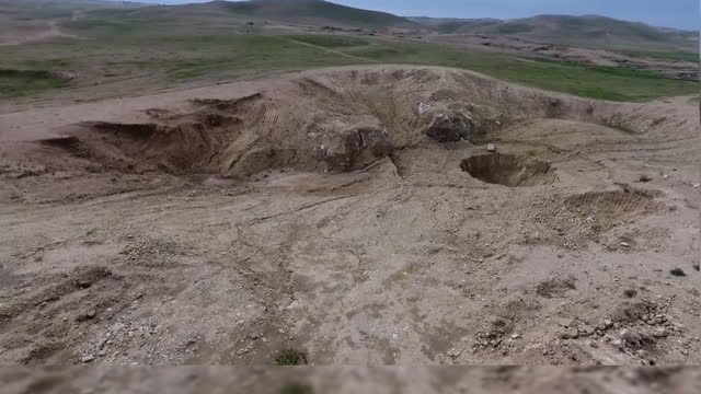 witnesses have told sky news that is fighters may have pushed as many as six thousand people into a sinkhole on the outskirts of mosul creating... - biggest stock videos & royalty-free footage