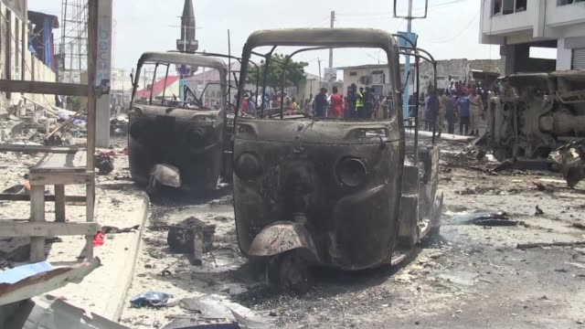 witnesses recount the moment two explosions rocked somalia's internal security ministry in mogadishu an attack claimed by shabaab militants which has... - corno d'africa video stock e b–roll