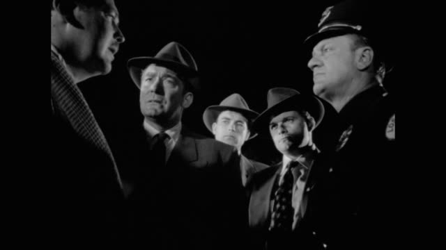 1948 witnesses to a shooting speak to officers at the scene of a crime - report produced segment stock videos & royalty-free footage