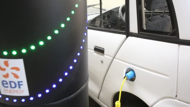 wizz electric car at a pavement recharging station in london. - cable stock videos & royalty-free footage