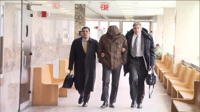 wojciech braszczok conceals his face as he walks out of court the off duty nypd cop who was a part of a biker attack on the west side highway will... - defendant stock videos and b-roll footage