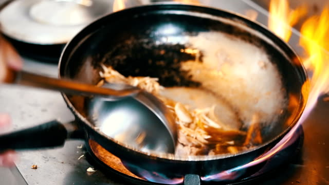 wok stir fry - chopped food stock videos and b-roll footage