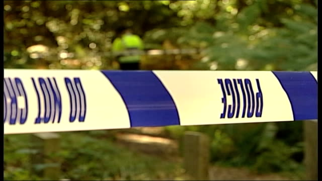 year old girl raped; england: surrey: woking: ext police tape marking off woodland where 13-year-old girl was raped pathway along which girl was... - investigatore video stock e b–roll