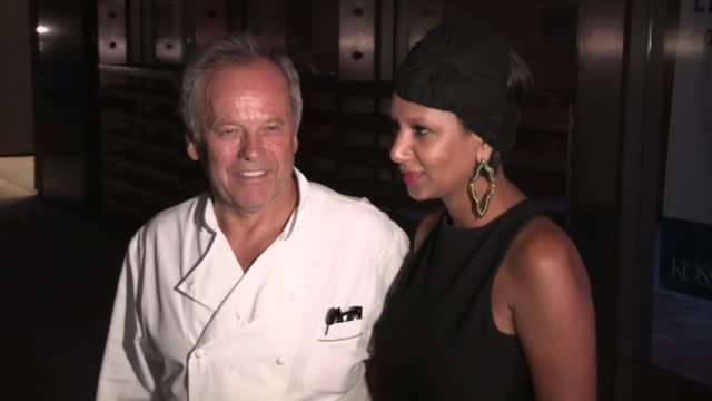 wolfgang puck and gelila assefa exchange greeting with paparazzi at spago in beverly hills at celebrity sightings in los angeles wolfgang puck and... - wolfgang puck stock videos & royalty-free footage