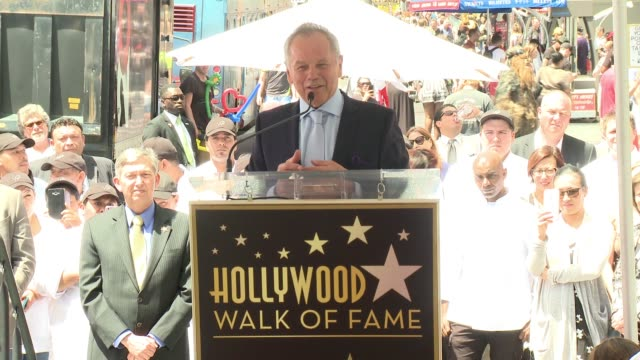 wolfgang puck honored with star on the hollywood walk of fame at hollywood walk of fame on april 26, 2017 in hollywood, california. - wolfgang puck stock videos & royalty-free footage