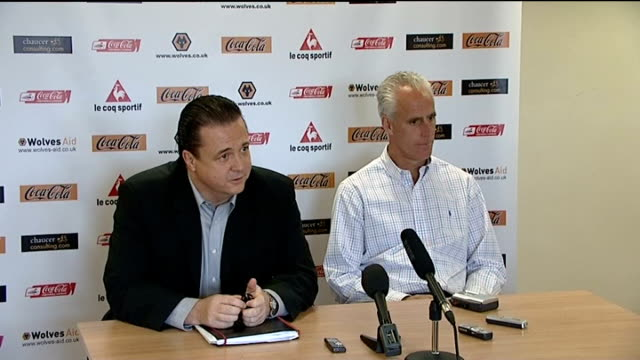 press conference ENGLAND Wolverhampton Molineux INT Mick McCarthy walks in to press conference with Jez Moxey Press conference setups Moxey press...