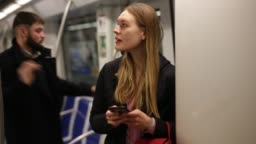 woman absorbed in her smartphone while traveling