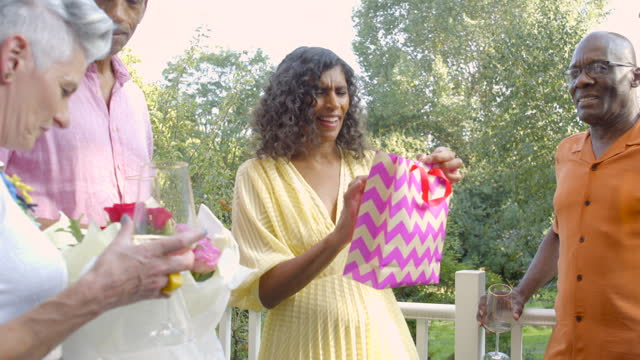 a woman accepts a gift bag - wine glass stock videos & royalty-free footage