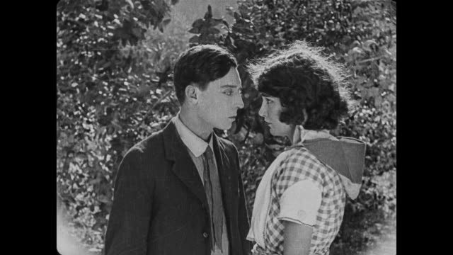 1920 woman (sybil seely) accepts marriage proposal from unsuspecting man (buster keaton) - 無声映画点の映像素材/bロール