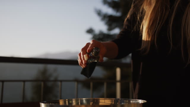 woman adding red wine vinegar to a mixed bowl of microgreens - 酢点の映像素材/bロール