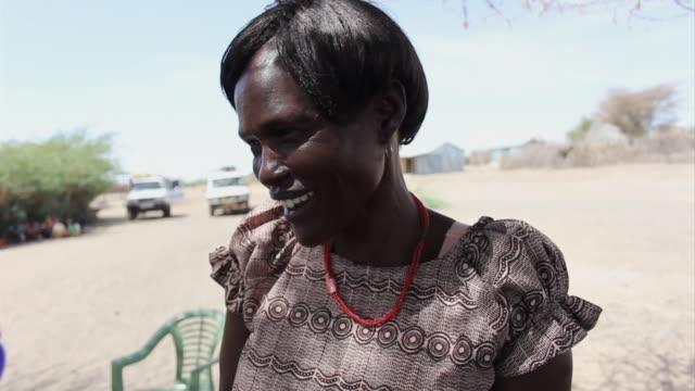 ms woman addresses meeting under tree / nackhukui, turkana, kenya - village stock videos & royalty-free footage