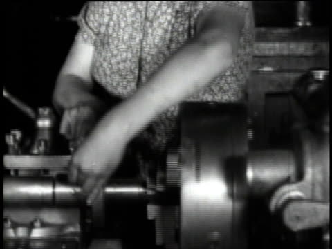 woman adjusting machine / woman operating lathe / turning machine with lubrication / finished turned spindles - lubrication stock videos & royalty-free footage