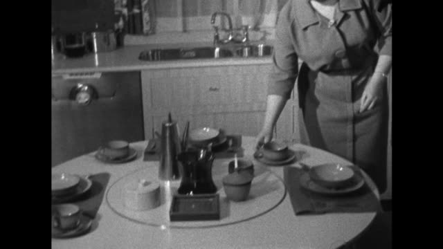 a woman admires a modern kitchen display at the ideal home exhibition at london's earl court - exhibition stock videos & royalty-free footage