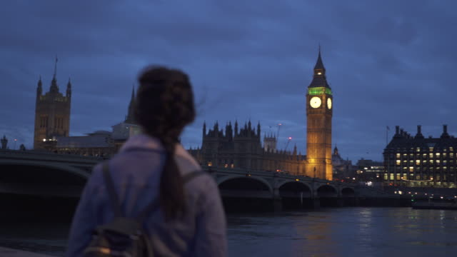 woman admires big ben in london - standing stock videos & royalty-free footage
