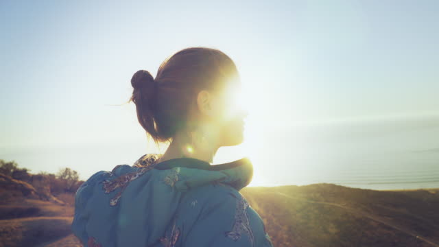 woman admires the mountain top view - beautiful woman stock videos & royalty-free footage