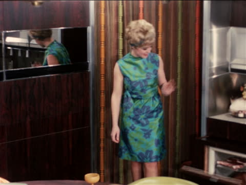 1968 woman admiring automated futuristic kitchen / industrial - 1968 stock videos and b-roll footage
