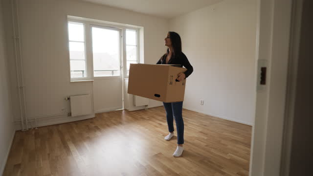 woman admiring her new home - carrying stock videos & royalty-free footage