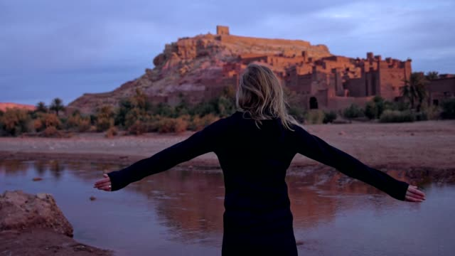 Woman admiring majestic old buildings in Aït Benhaddou