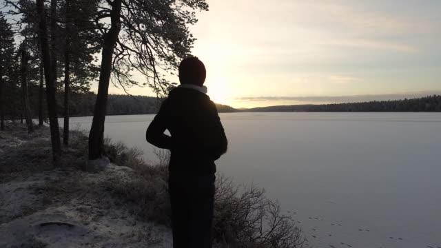 Woman admiring the view, Pallas-Yllästunturi National Park, Lapland, Finland