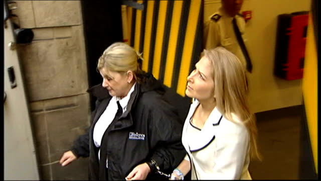 vídeos de stock, filmes e b-roll de woman admits killing her three children scotland edinburgh high court theresa riggi being led from court in handcuffs and along to prison van - algema