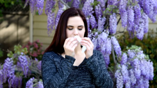 woman allergic to flowers - facial tissue stock videos & royalty-free footage