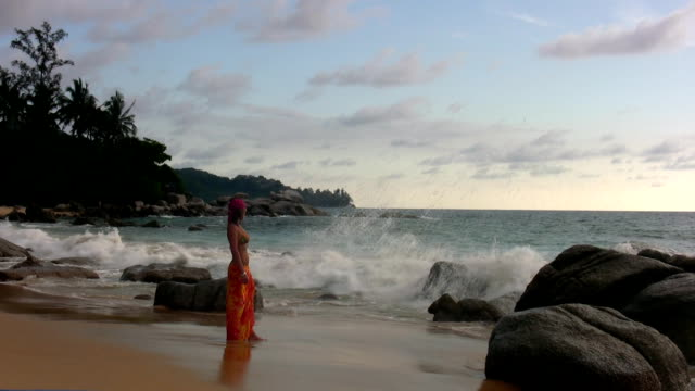 woman alone at the beach - sarong stock videos and b-roll footage