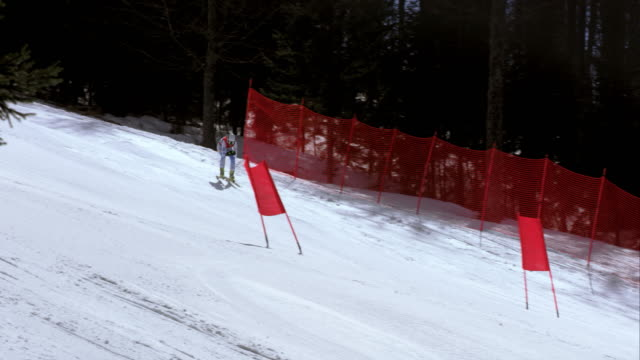 TS Woman alpine skier skiing at downhill race