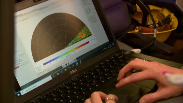 woman analyzes a doppler radar feed during the kincade fire in california. - radar stock videos & royalty-free footage