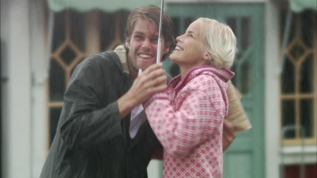 A woman and a man meets under an umbrella Sweden.