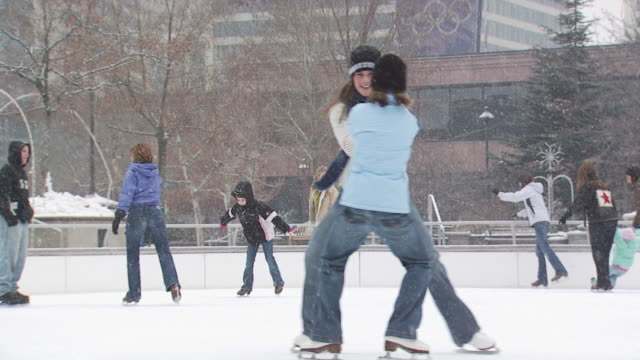 a woman and a young girl playing at an ice rink - see other clips from this shoot 1145 stock videos & royalty-free footage