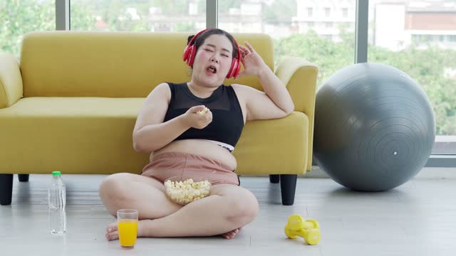 woman and asian girl enjoy eating food on sofa at home - over eating stock videos & royalty-free footage