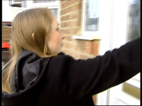 Woman and baby along street towards and past CS Finger pushing door bell MS Glass in door as child minder opens the door TMS Woman and child coming...