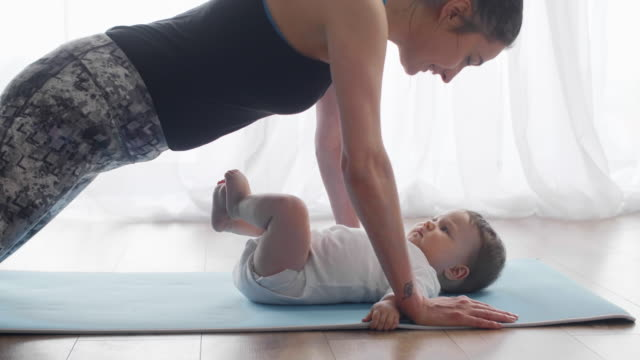 woman and baby exercising at home/ debica/ poland - push ups stock videos & royalty-free footage