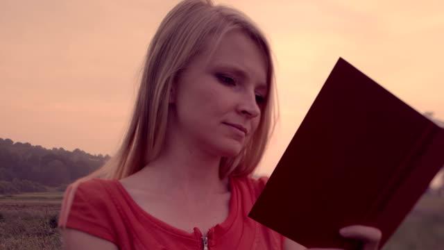 woman and book. - endast unga kvinnor bildbanksvideor och videomaterial från bakom kulisserna
