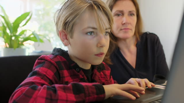 woman and boy with laptop - elementary age stock videos & royalty-free footage