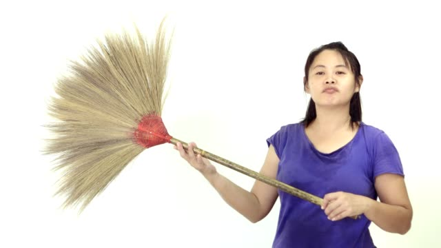 woman and broom-cotton swab cleaning room
