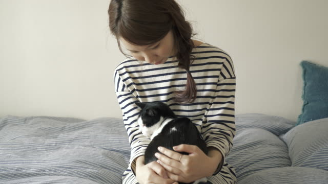 Woman and cat relaxing on the bed