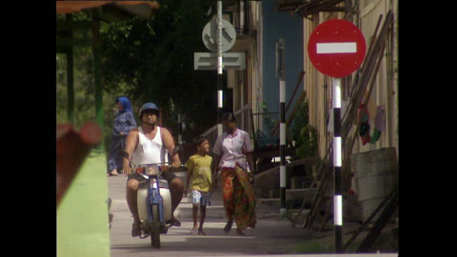 woman and child walk down city street in kuala lumpur; 1996 - 1996 stock videos & royalty-free footage